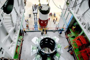 Hoisting of nozzle end segment of PSLV-C42 first stage over launch pedestal