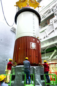 Placement of nozzle end segment of PSLV-C42 first stage over the launch pedestal