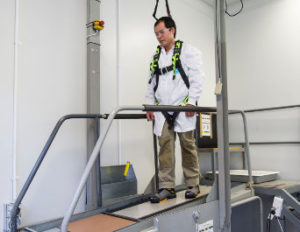 researcher in a harness on the slip test machine