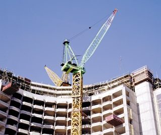 Crane being used in the construction of a high-rise building