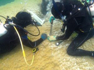 Coring of coral (Porites spp.) using specialised equipment.