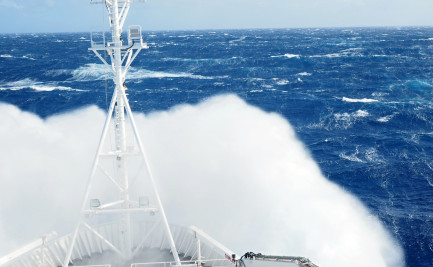 Waves crashing over the bow of a ship