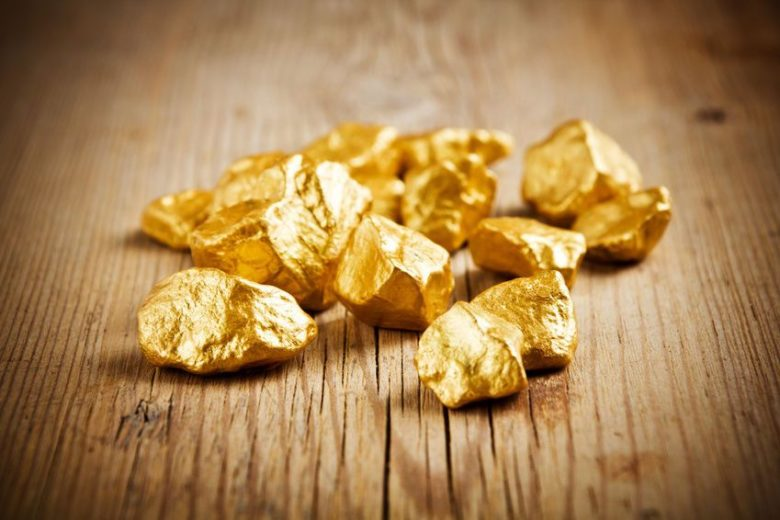Gold nuggets on a wooden table
