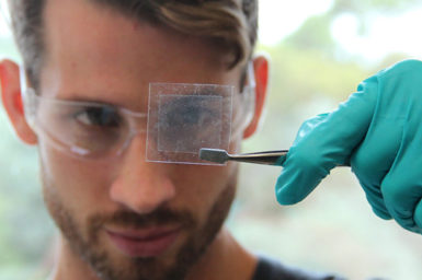 Man with beard looking at a graphene piece