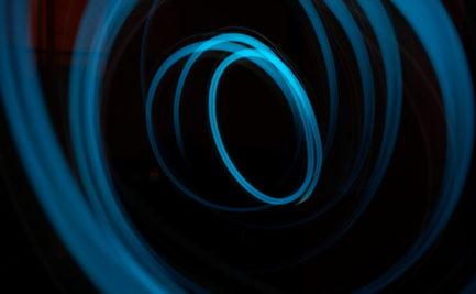 blue swizzle on black background