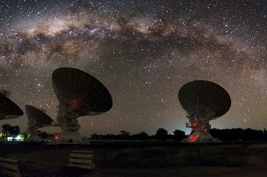 ATCA radiotelescope dishes under a night sky