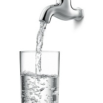 water from tap filling glass